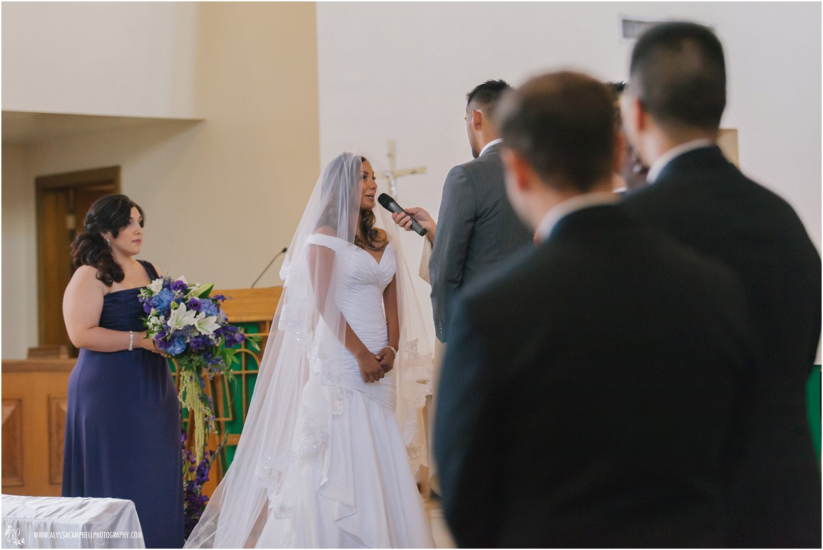 bride saying vows at St Agnes Catholic church in Phoenix