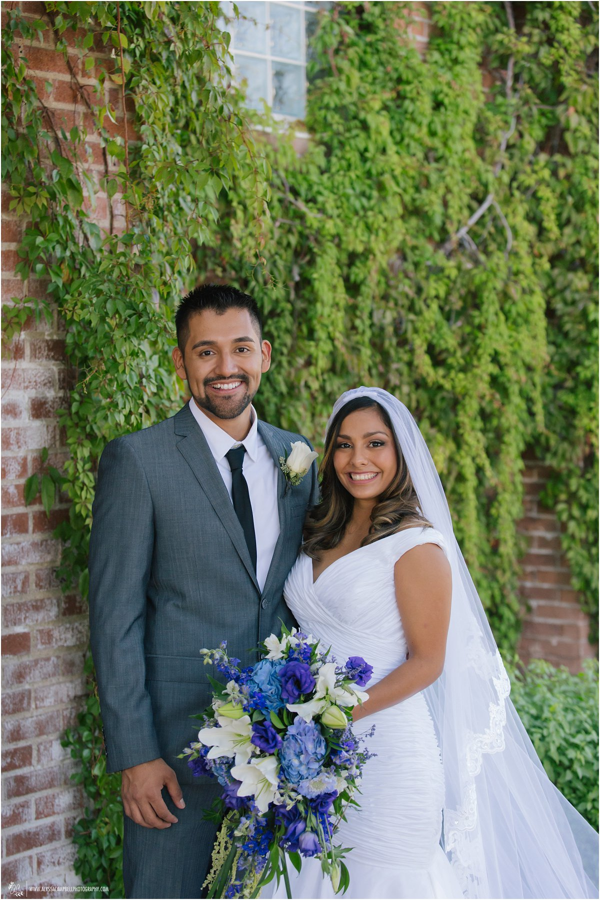 St Agnes Catholic Church Phoenix bride & groom portraits in front of ivy wall