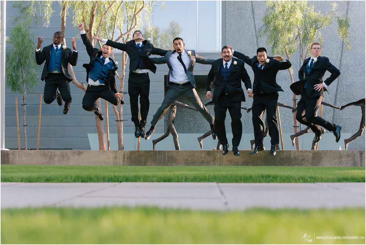 groomsmen jumping at Phoenix Art Museum wedding