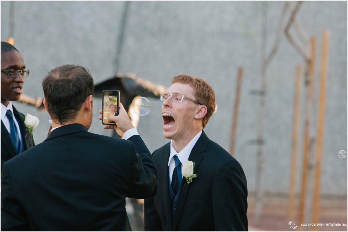 groomsmen doing funny things at weddings Phoenix Art Museum wedding