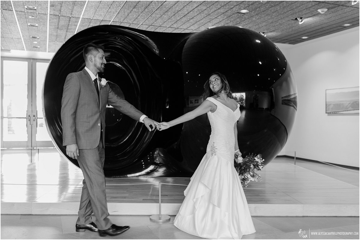bride & groom in front of art sculpture Phoenix Art Museum