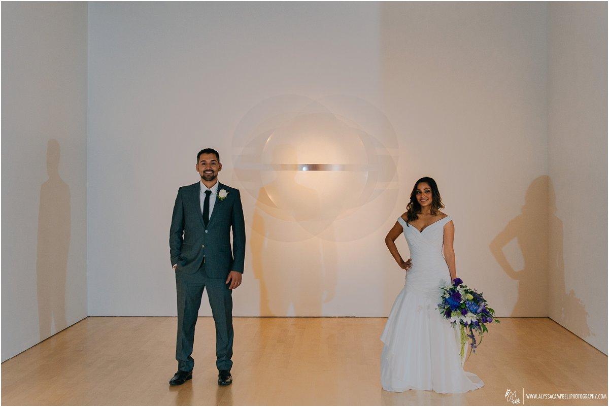 bride & groom in front of 3D sculpture Phoenix Art Museum