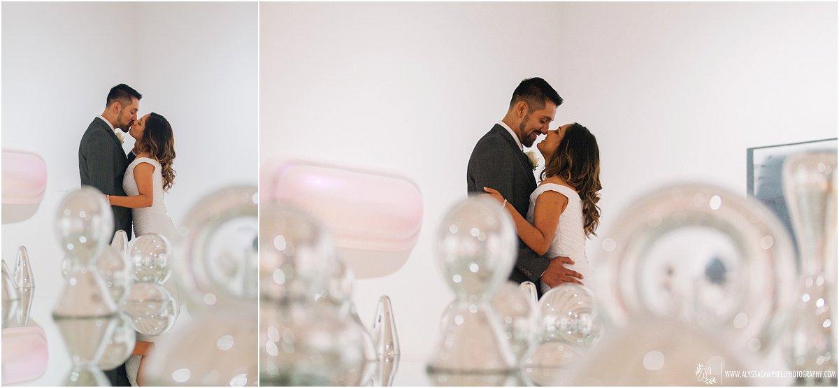 bride & groom in front of mirror sculpture table Phoenix Art Museum wedding