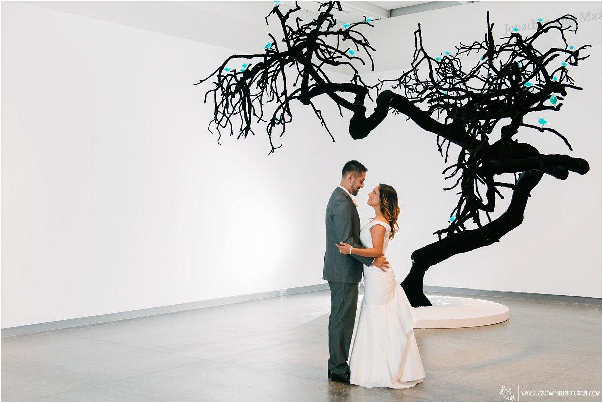 bride & groom infront of black tree at Phoenix Art museum wedding