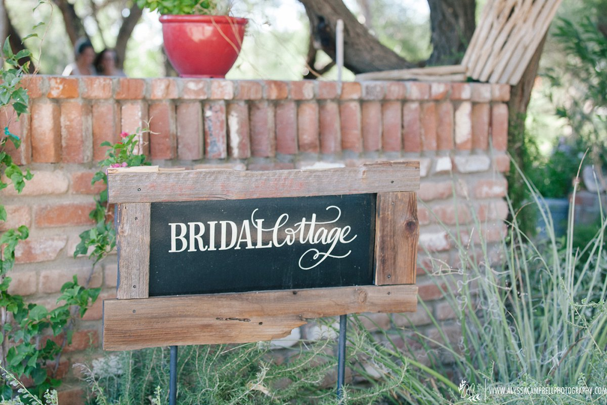 bridal cottage sign at rustic barn wedding venue in Florence AZ by Arizona wedding photographer Alyssa Campbell