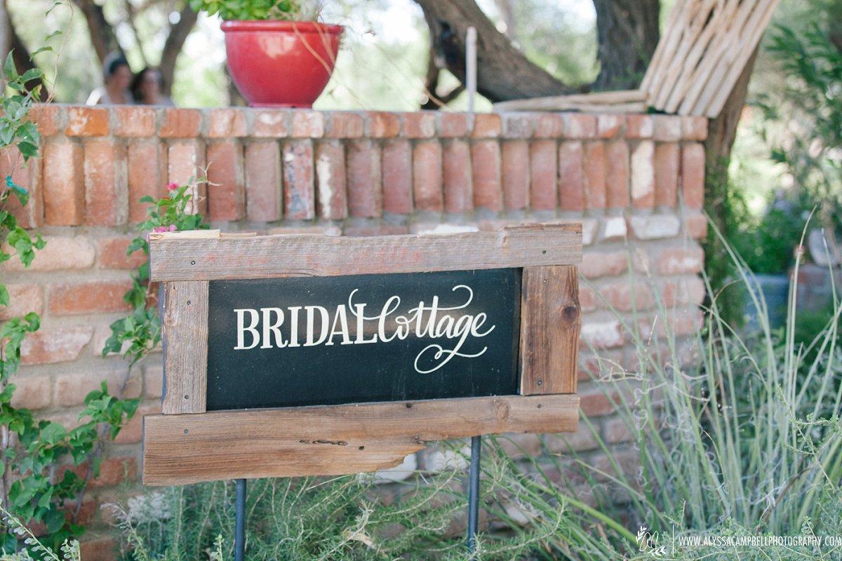 bridal cottage sign at rustic barn wedding venue in Florence AZ by Arizona wedding photographer Alyssa Campbell