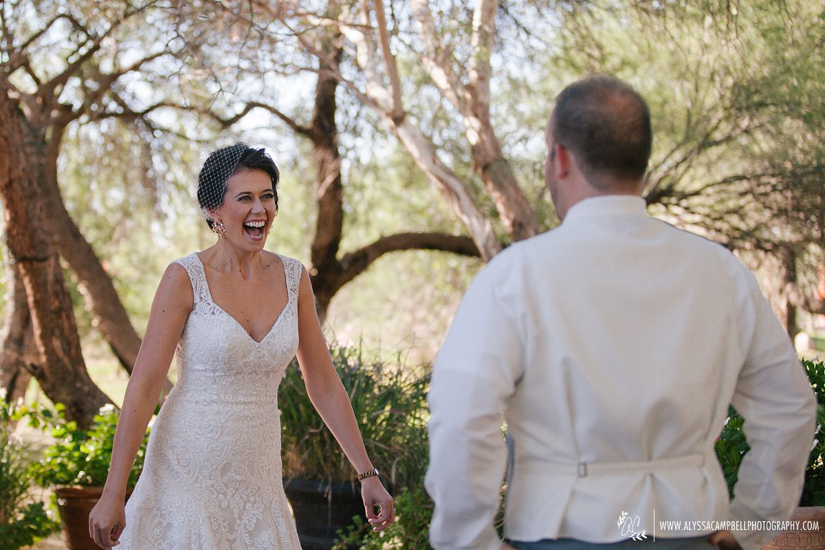 cute bride reaction first look at Windmill Winery wedding Florence AZ