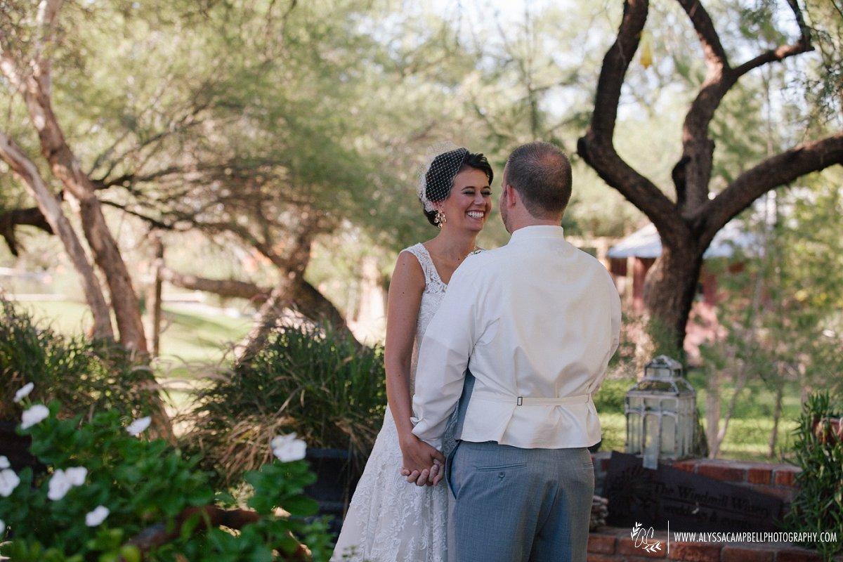 bride & groom first look Windmill Winery wedding rustic barn venue