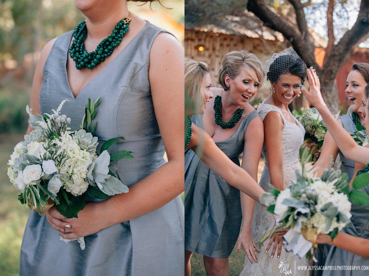 bride and bridesmaids team hand gesture at Windmill Winery elegant rustic wedding venue