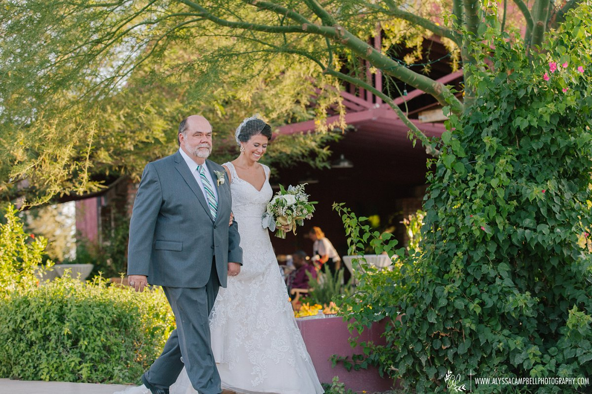 father & bride walking down aisle at Windmill Winery barn wedding