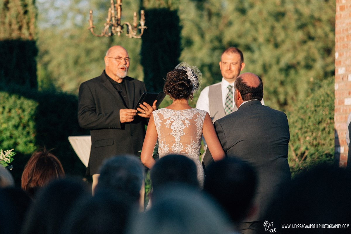 father giving bride away at Windmill Winery wedding with lace wedding dress with portrait lace back