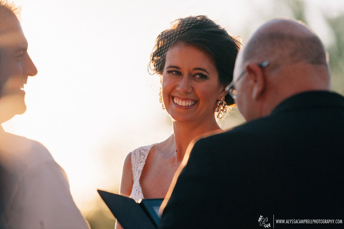 bride smiling at Windmill Winery wedding during ceremony