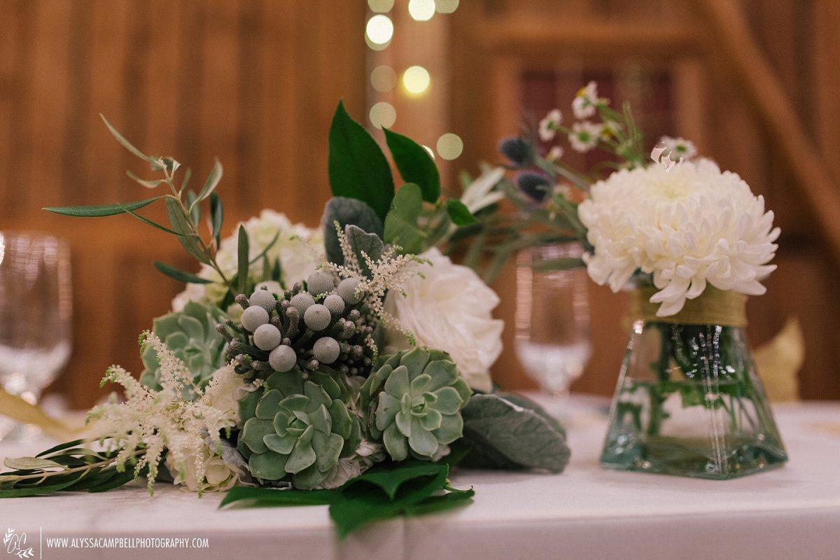 floral centerpieces at Windmill Winery wedding Sarah's Garden florist by Alyssa Campbell Photography Arizona wedding photographer