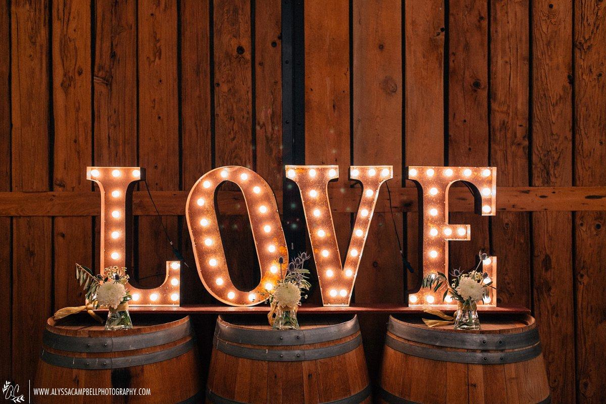 Windmill Winery barn reception Love sign