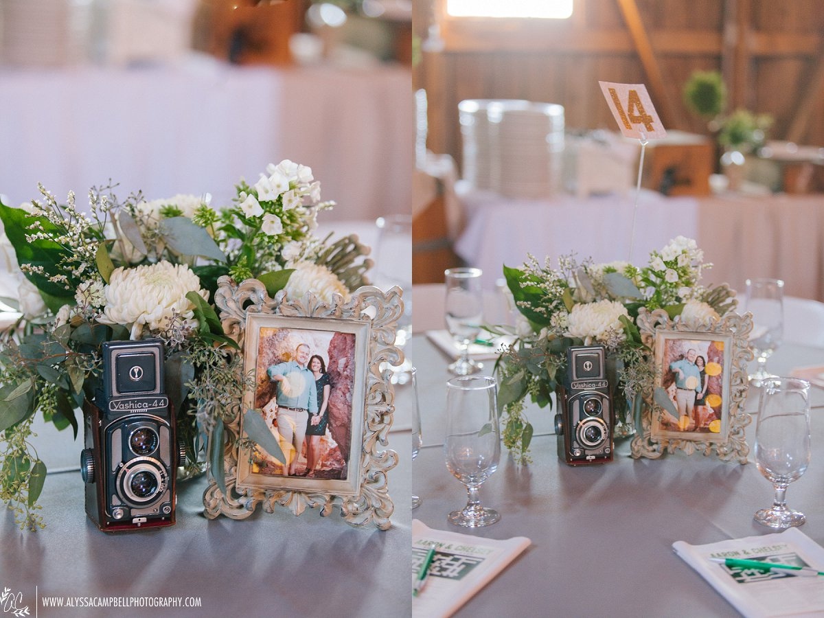 floral & vintage camera centerpieces at elegant rustic Windmill Winery barn wedding by Arizona wedding photographer Alyssa Campbell