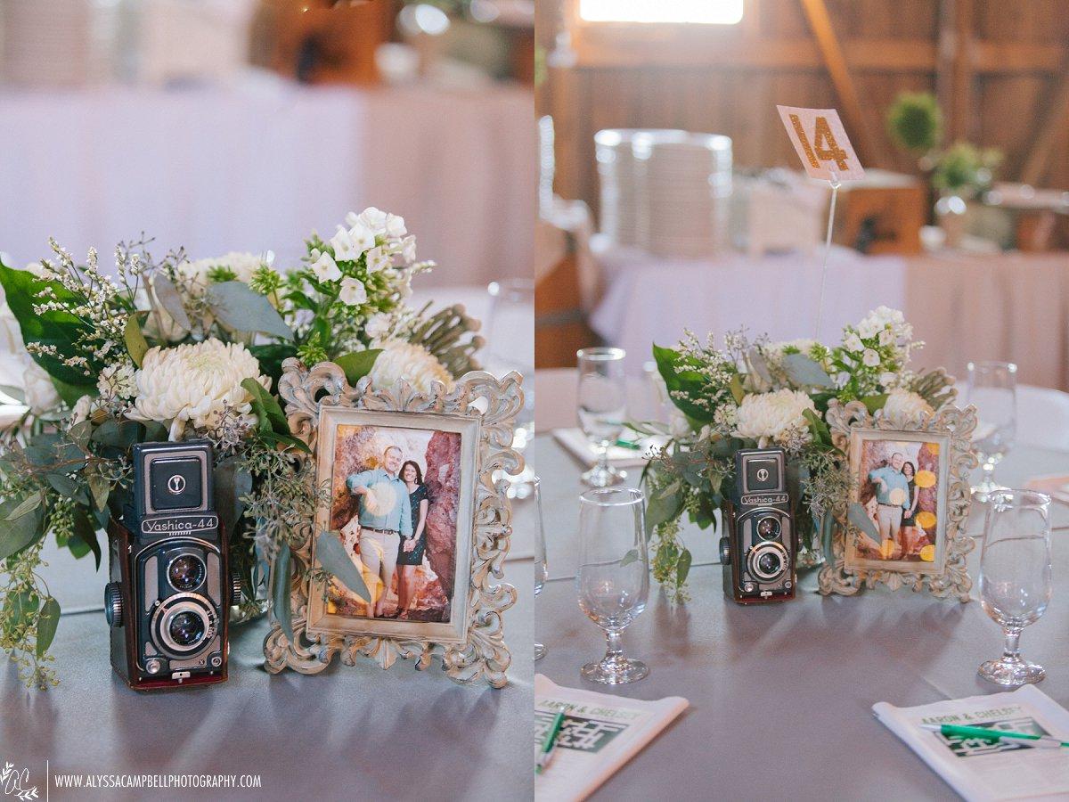 floral & vintage camera centerpieces at elegant rustic Windmill Winery barn wedding by Arizona wedding photographer Alyssa Campbell