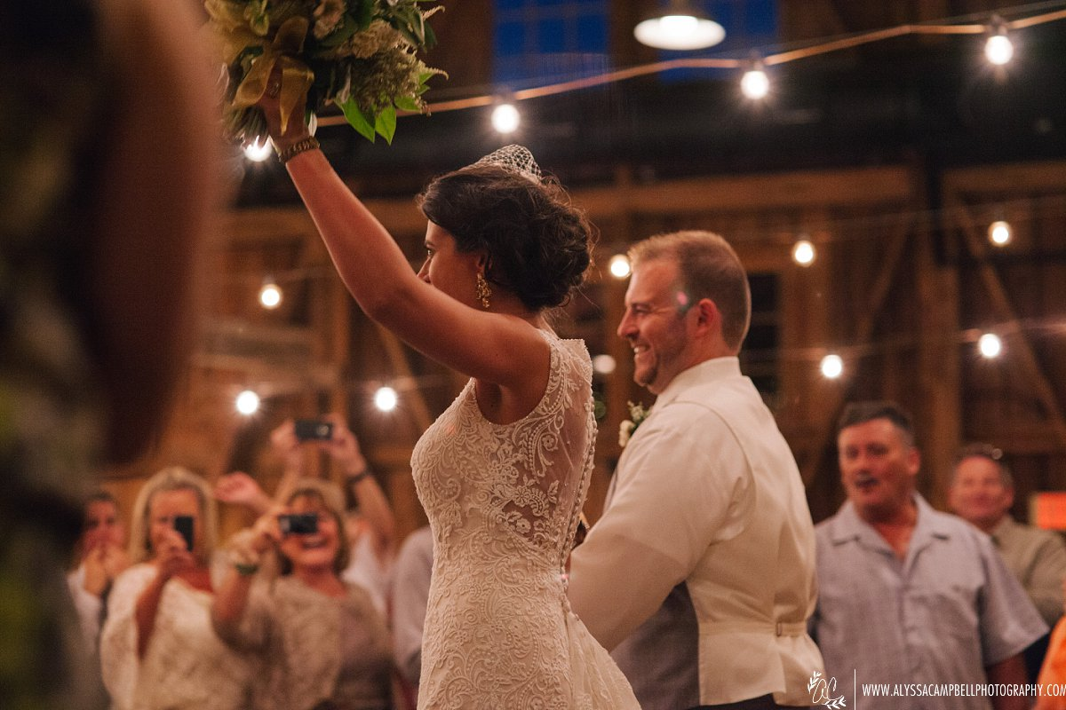 bride & groom entering reception for first time at Windmill Winery wedding reception