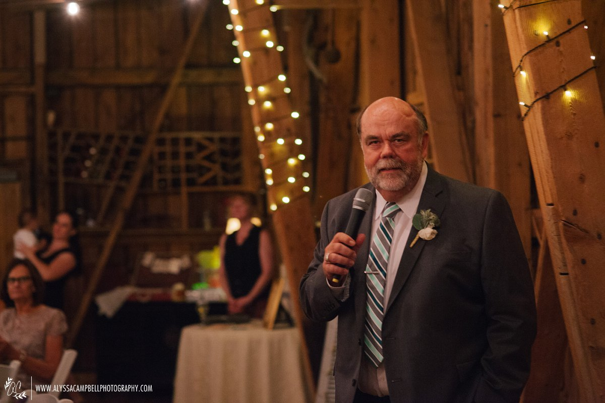 father of the bride giving toasts at Windmill Winery rustic barn wedding reception