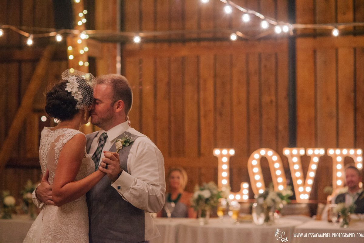 bride & groom first dance at rustic barn wedding venue Windmill Winery