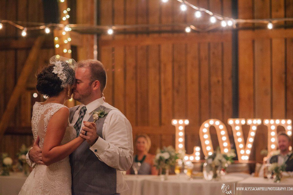 bride & groom first dance at rustic barn wedding venue Windmill Winery