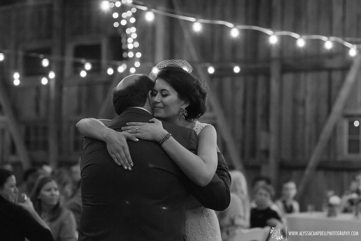 bride hugging father after dance at wedding reception at Windmill Winery wedding