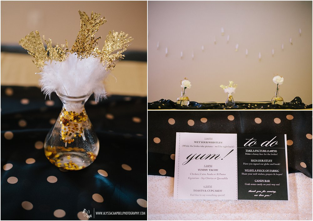 gold glitter dipped feathers with black & gold dot table cloths & DIY programs at Foothills Christian Church by Arizona same sex wedding photographer