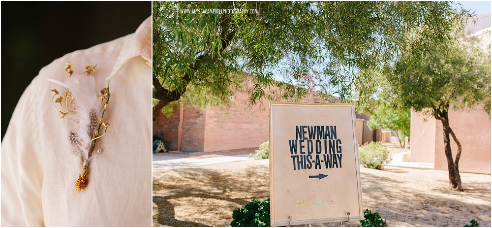 feather and gold boutineer sign to wedding on picture frame by Arizona LGBT friendly wedding photographer