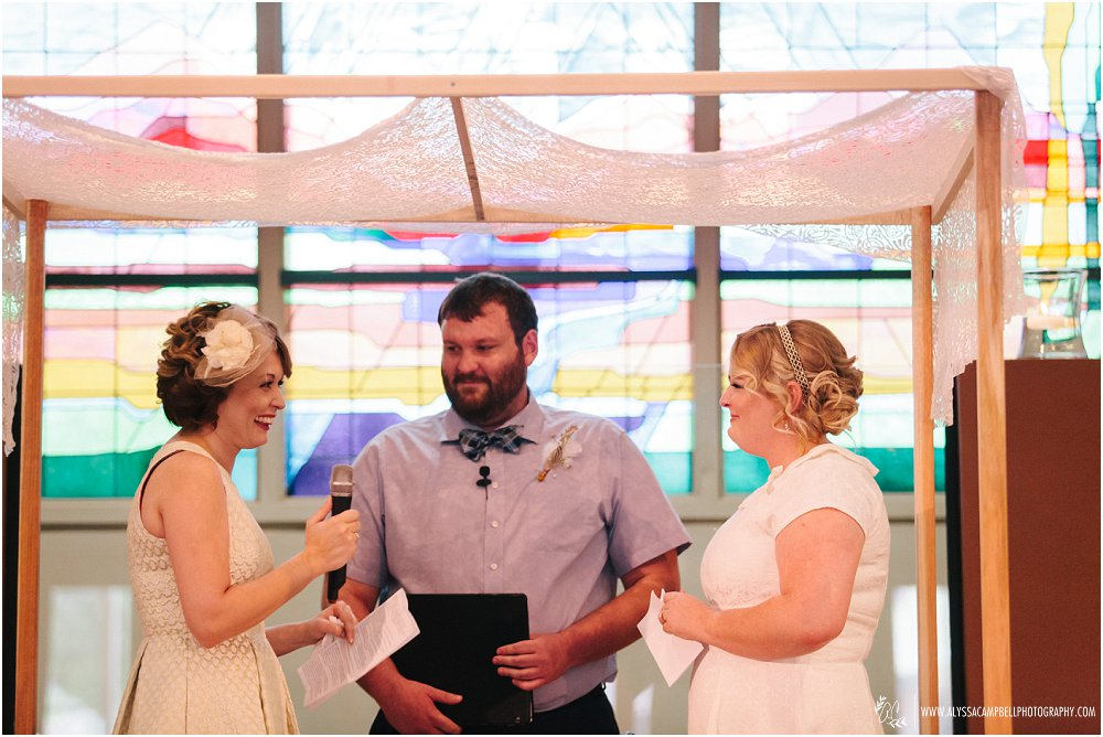 same sex wedding Phoenix AZ two brides saying vows to each other Christian ceremony