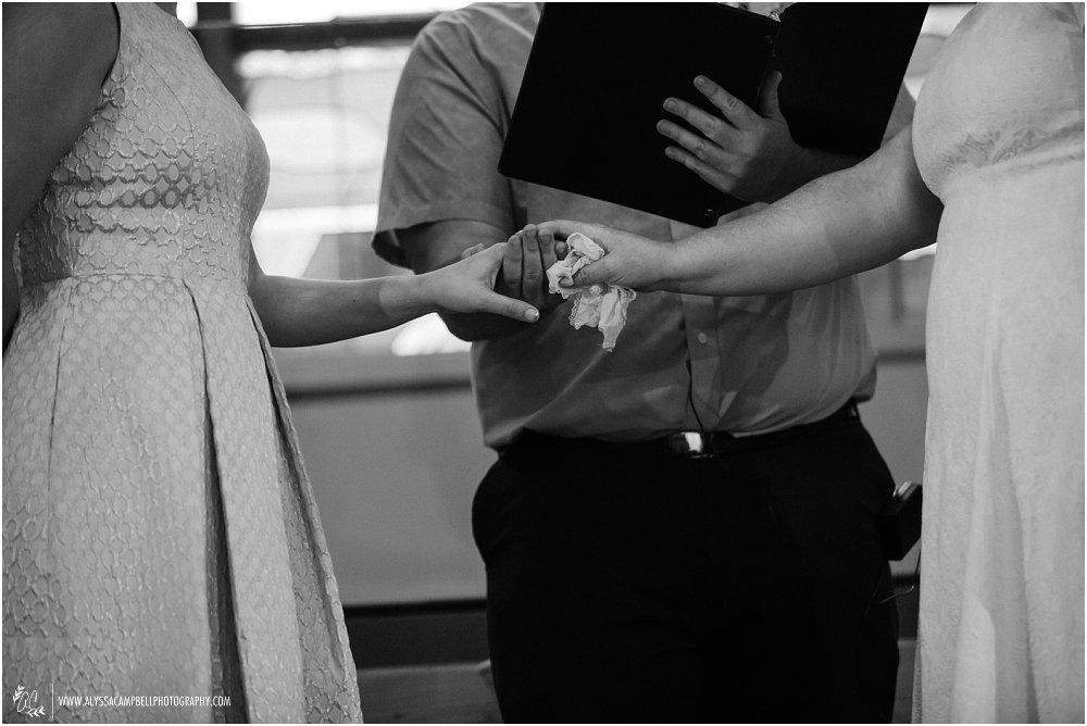 two brides holding hands during Christian wedding ceremony in Phoenix, AZ