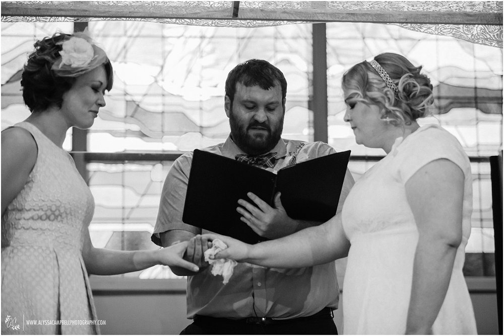 pastor blessing rings of two lesbian brides Foothills Christian Church AZ