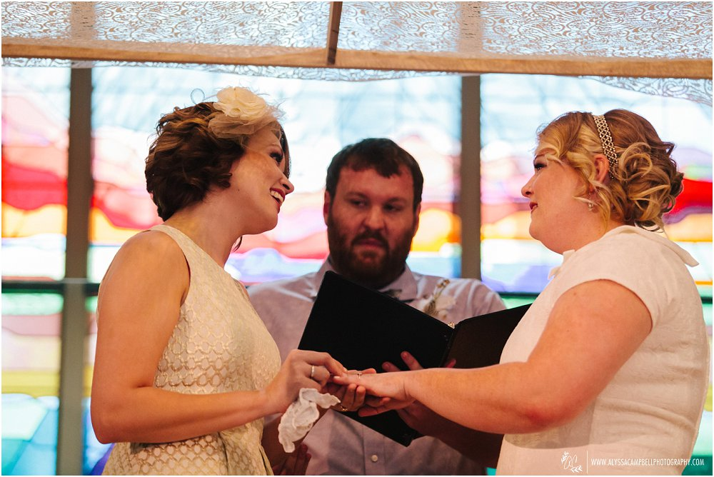 lesbian brides exchanging rings in Christian church Phoenix