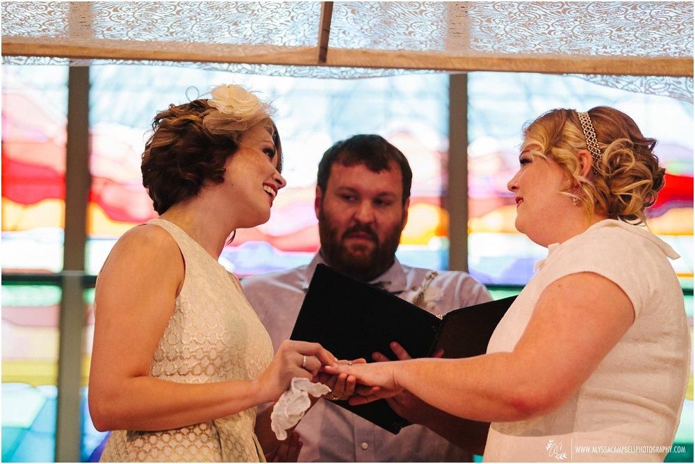 lesbian brides exchanging rings in Christian church Phoenix