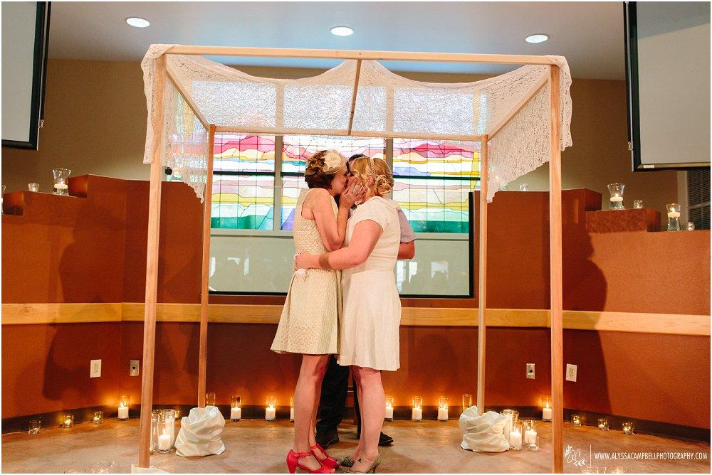 two brides kissing at LGBT friendly church Phoenix AZ