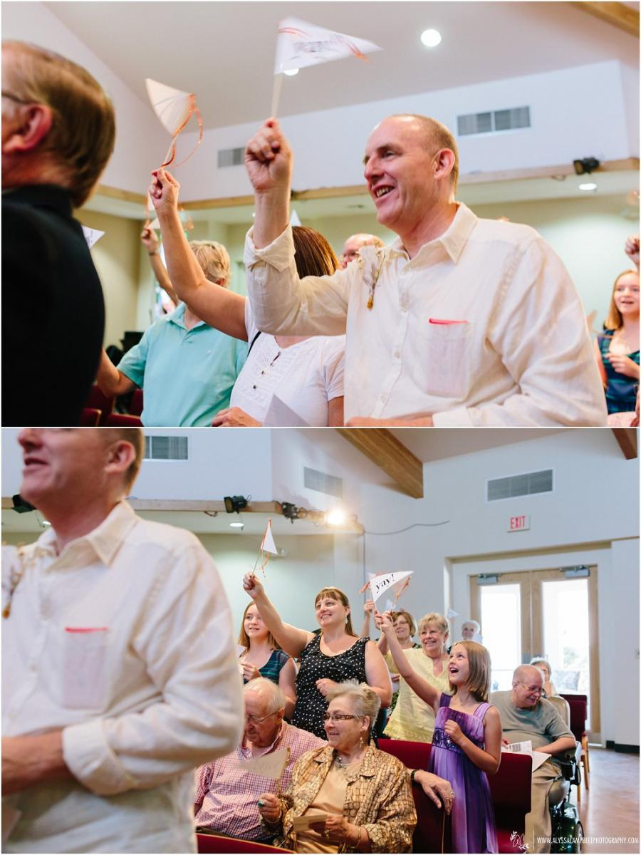 guests waving flags at wedding ceremony at Foothills Christian Church