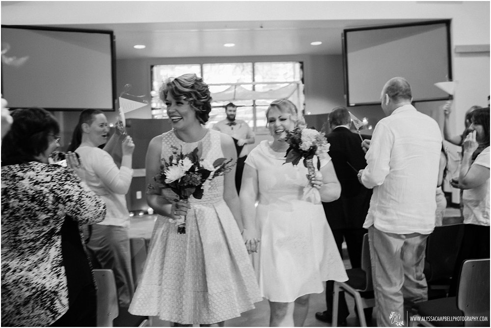 two brides just married at Phoenix AZ church Foothills Christian recessional