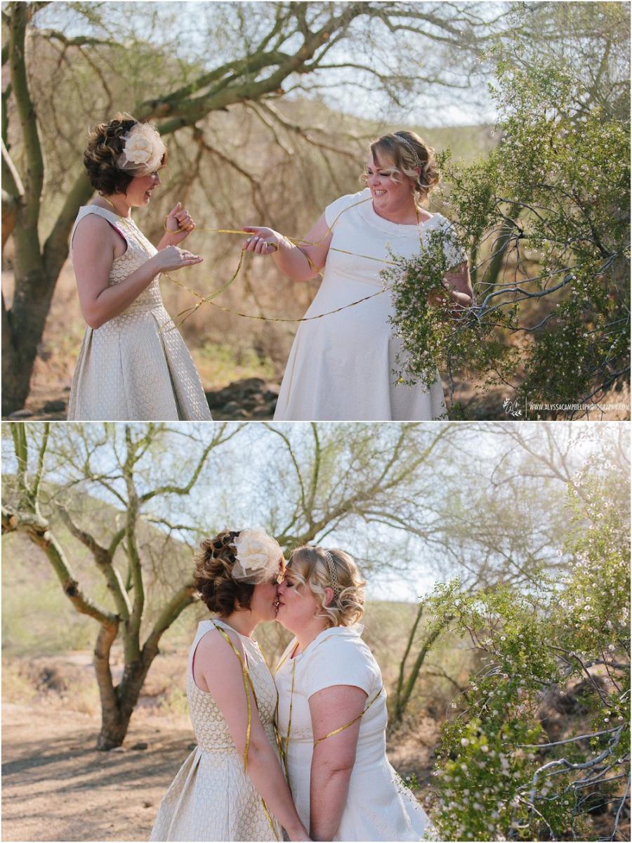 lesbian bride reeling in her partner laughing