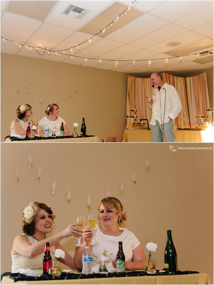 toasts to the brides at Foothills Christian Church Arizona lesbian wedding photographer