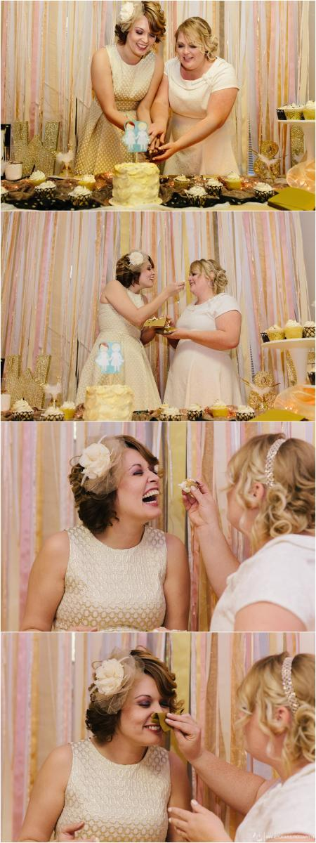 two brides cutting the cake with gold DIY streamer backdrop by Arizona lesbian wedding photographer