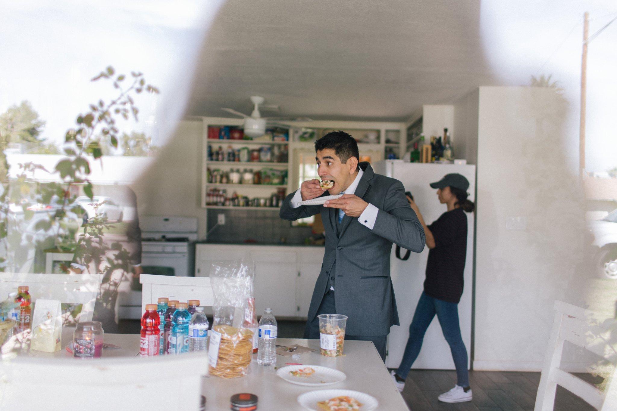 documentary Phoenix wedding photographer groomsman eating tacos