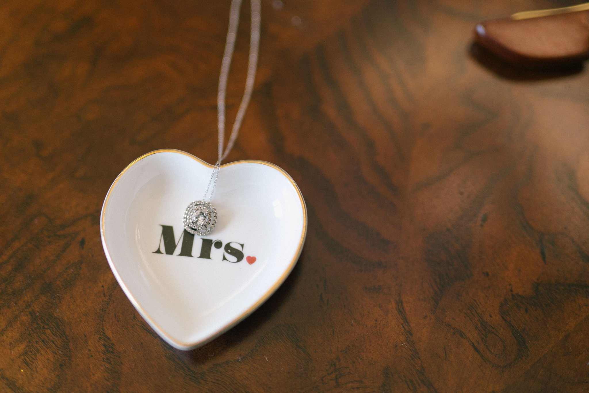 Phoenix wedding details necklace in Mrs heart shaped dish