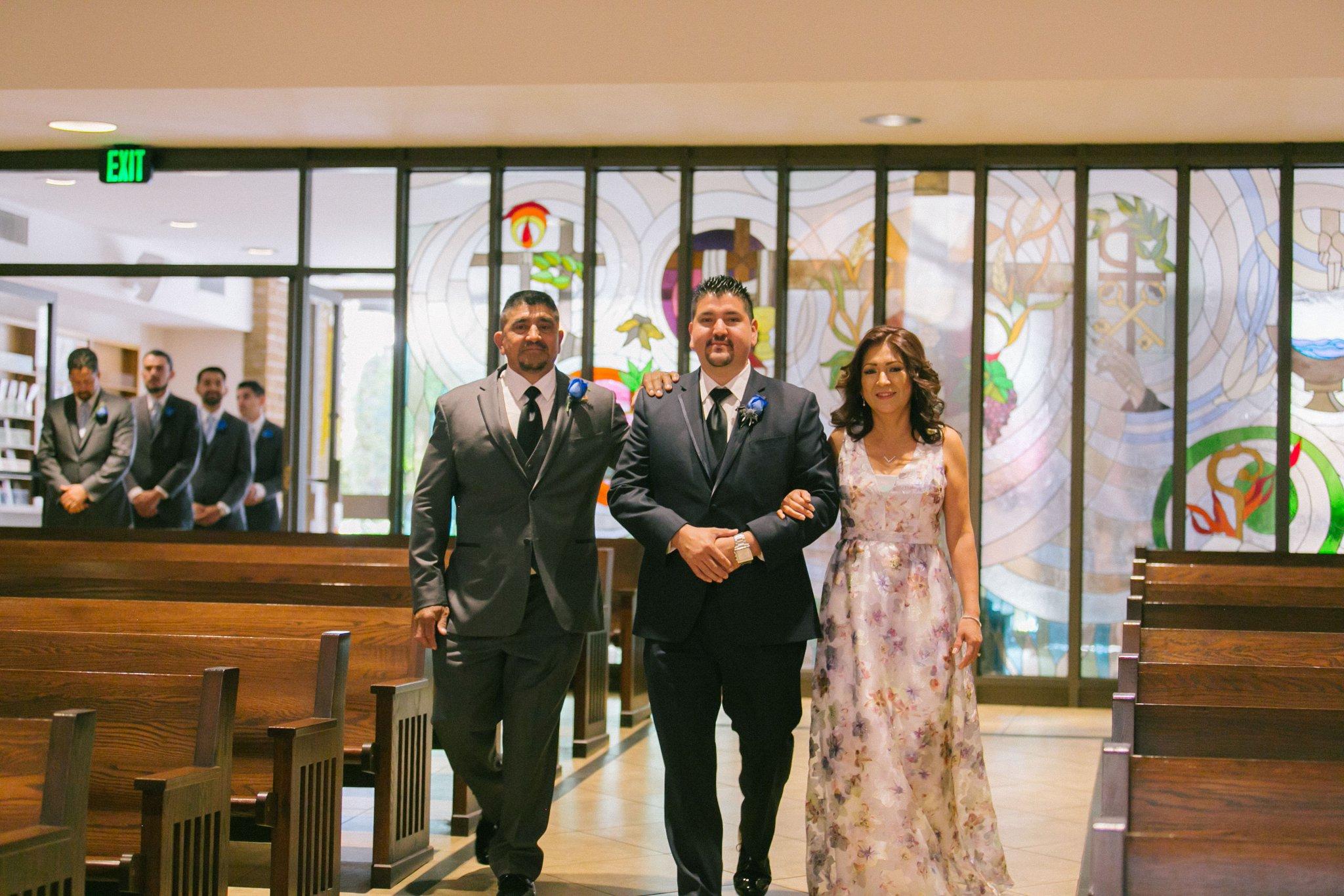 St Teresa Parish Phoenix wedding groom walking down aisle with both parents