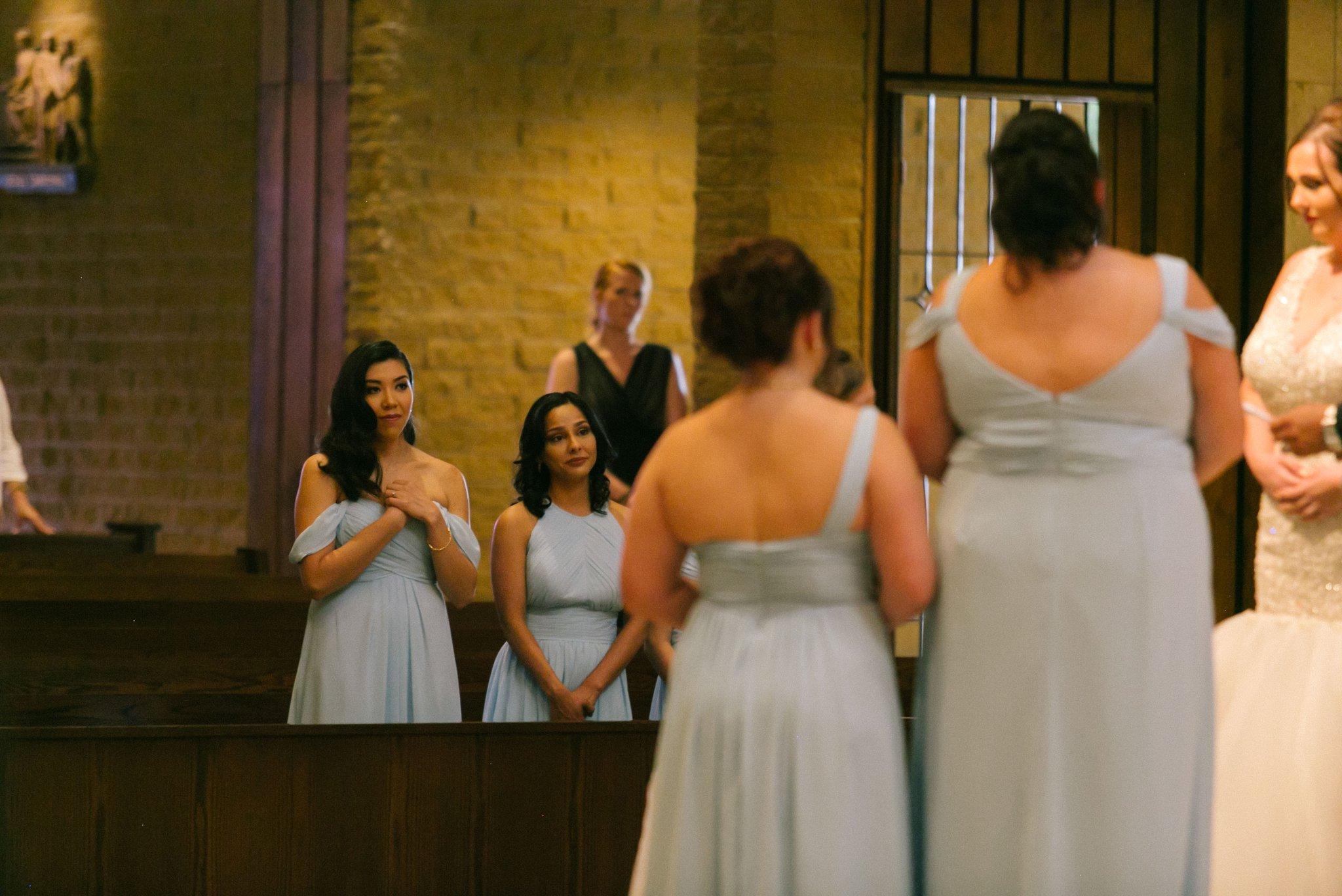 emotional moment bridesmaids during Catholic wedding ceremony Phoenix documentary photographer Phoenix