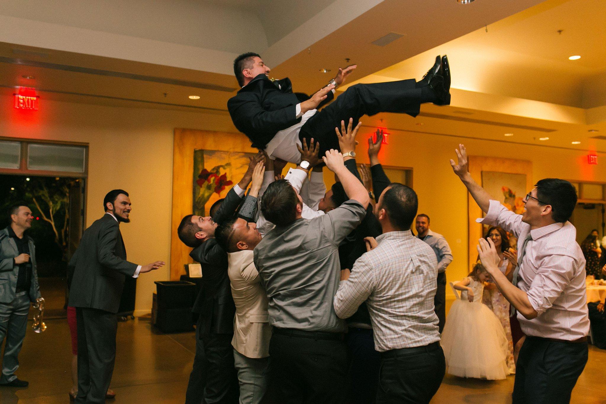 Desert Botanical Gardens reception tossing groom in the air