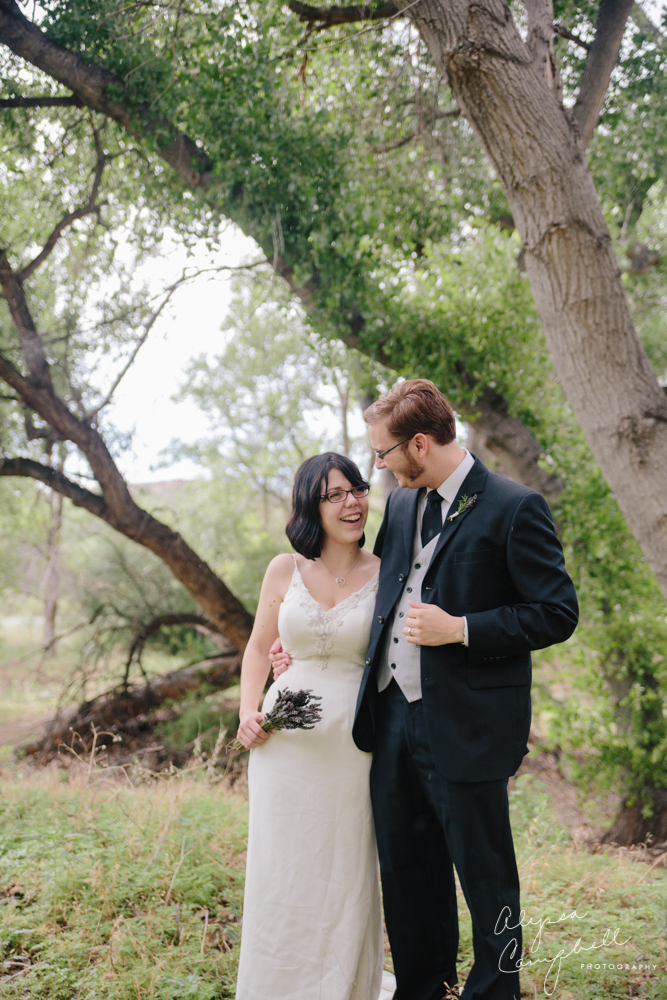 bride and groom with glasses at Prescott Riparian habitat