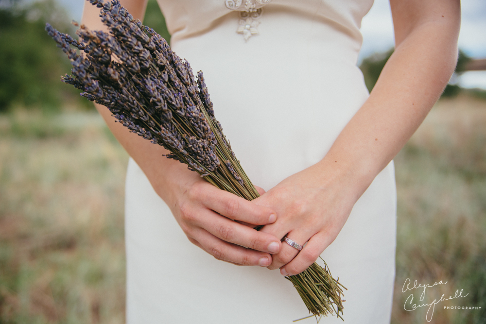 bride holding dried lavender bouquet in Prescott forest