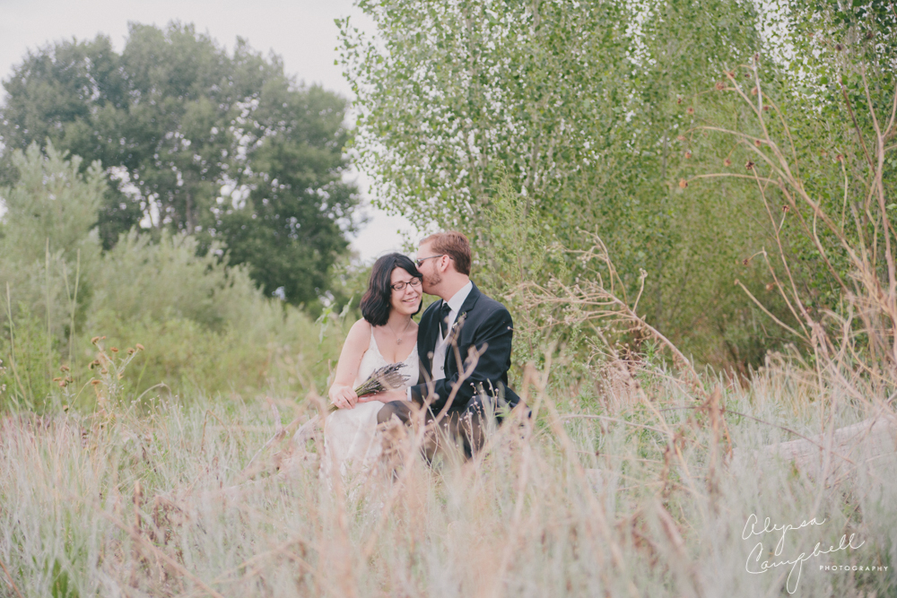 bride and groom in field in Prescott