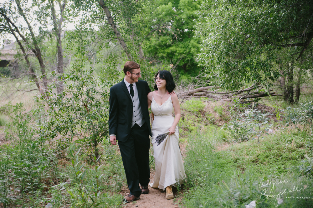 bride and groom in hiking boots walking in riparian habitat Prescott Arizona