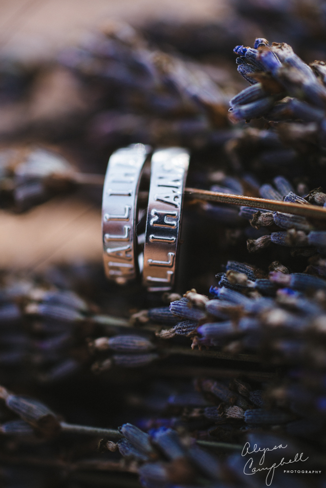 dogtag wedding rings on dried lavender flowers