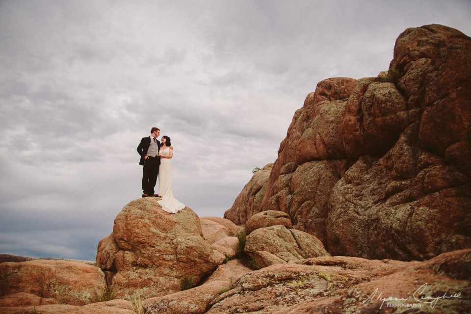 bride and groom on rocky landscape in Arizona