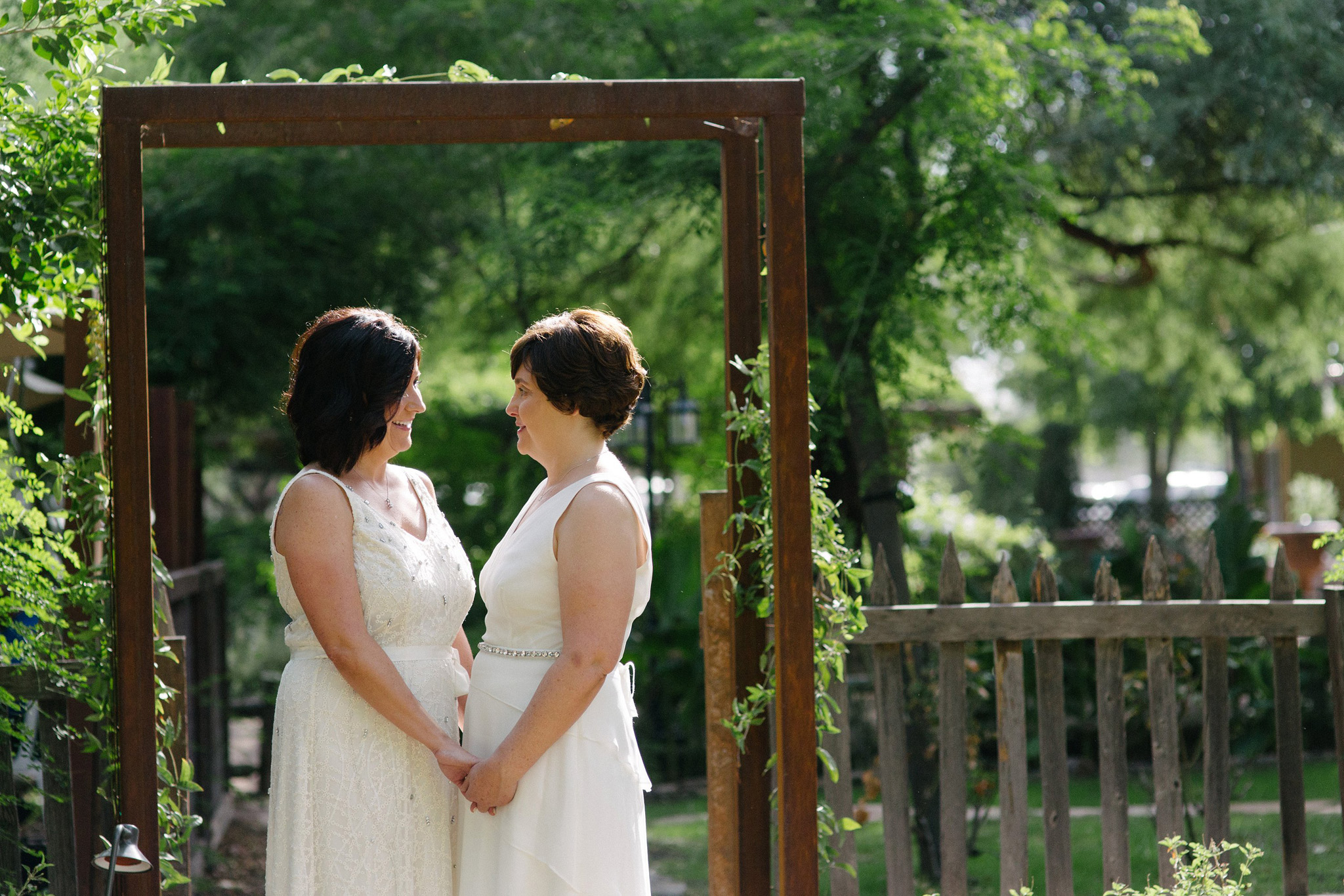two brides in white dresses older first look at the farm at south mountain wedding